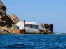 Sardinia. Gonnesa. Ancient fishmen house and ruins of a coastal defense tower of 18th century in Portupalla beach, South-western Sardinia Royalty Free Stock Image