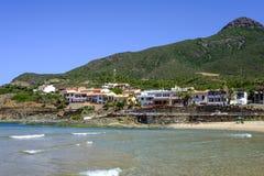 Sardinia, italy, europe, the south west coast, beach san nicolò. View san nicolò beach in the south west coast of sardinia with the village of portixeddu royalty free stock photography
