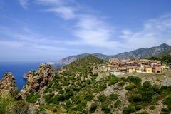Sardinia, italy europe, south west coast, the faraglioni. View of the faraglioni with a modern tourist village on the south western coast of sardinia stock image
