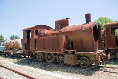 In Sardinia, Italy, old trains stand and rust at train station stock images