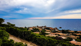 Sardinia kust i en molnig dag Royaltyfria Bilder