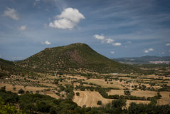 Sardinia Landscape.Old volcanic dome. Panoramic view of outcrop of andesitic lava in Cixerri plane.Sardinia.Italy Stock Image