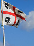Sardinia. Old flag to wind Royalty Free Stock Images