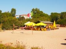 Sardinia porto istanastång på stranden Arkivfoto