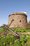 Sardinia. Portoscuso. Spanish Tower and old anchor Stock Photo