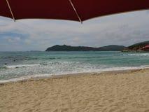 Sardinia sea red umbrella Stock Image