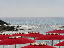 Sardinia sea red umbrella Royalty Free Stock Photos