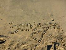 Sardinia sea sardegna. Sardinia sea writing sardegna on the beach stock photos