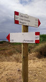 Sardinia. Sulcis - Iglesiente. Pole with two directional and time signals on trekking paths in southern Sardinia Stock Photography