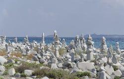 Sardinian beach with stones art work Stock Images