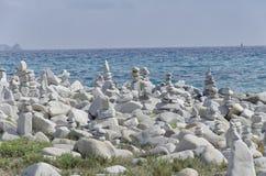 Sardinian beach with stones artwork Stock Photography