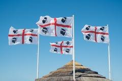 Sardinian flags. Sardinia Italy - Europe. Sardinian flags on San Teodoro beach. Sardinia Italy - Europe Royalty Free Stock Image