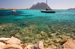 Sardinian holidays. Beautifull sea in Sardinia and Tavolara island, Italy Royalty Free Stock Photo