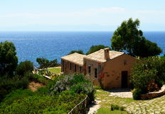 Sardinian home overlooking sea Royalty Free Stock Photography