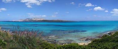 Sardinian landscape of La Pelosa beach in a sunny day stock photo