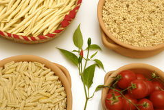 Sardinian pasta and tomatoes. Traditional pasta from Sardinia, small tomatoes and fresh chili pepper Royalty Free Stock Image