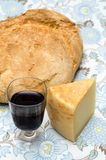 Sardinian products. Glass of red wine and slice of pecorino sardo cheese, on the table Stock Photos