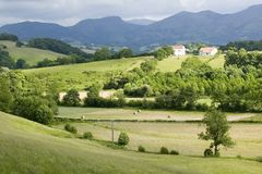 Sare, France in Basque Country on Spanish-French border, is a hilltop 17th century village surrounded by farm fields and mount Rhu Stock Image