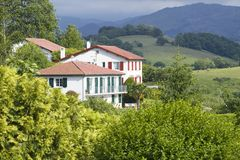 Sare, France in Basque Country on Spanish-French border, is a hilltop 17th century village surrounded by farm fields and mount Rhu Stock Images
