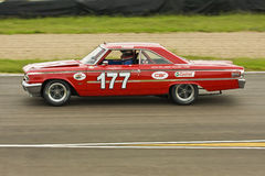 Sarel van der Merwe. SA racing legend in his Ford Galaxie of 1963. Photo taken at the Zwartkops raceway in South Africa on 31 January 2009 royalty free stock image