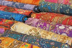 Sari. Bright colored fabrics India. It is built on the market. H. And Embroidery India. Tablecloths of different colors are sold at the bazaar in India, Goa stock photography