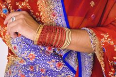 Sari Detail and Bangles. This image shows a woman dressed in an Indian Sari and bangles royalty free stock photos