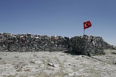 Sarikiz holy place with Turkish flag in mount ida,Edremit,Turkey. BALIKESIR, TURKEY- August ,28 2005 : The place where is located the tomb of sarikiz and today stock photo