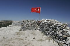 Sarikiz holy place with Turkish flag in mount ida,Edremit,Turkey. BALIKESIR, TURKEY- August ,28 2005 : The place where is located the tomb of sarikiz and today royalty free stock photos