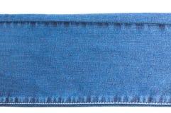 Sarja de Nimes e calças de brim fundo, peça das calças de brim com as emendas, longo, isoladas fotografia de stock