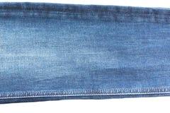 Sarja de Nimes e calças de brim fundo, peça das calças de brim com as emendas, longo, isoladas fotos de stock