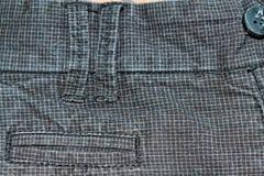 Sarja de Nimes suja em um quadrado com botões Obscuridade do vintage - calças de brim cinzentas, boas para o fundo Fotos de Stock Royalty Free