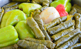 Sarma and dolma - Traditional Turkish food. Pepper and grape leaves stuffed with rice and minced meat. Stock Photography