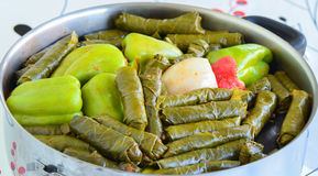 Sarma and dolma - Traditional Turkish food. Pepper and grape leaves stuffed with rice and minced meat. Stock Images