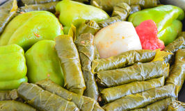 Sarma and dolma - Traditional Turkish food. Pepper and grape leaves stuffed with rice and minced meat. Stock Photo