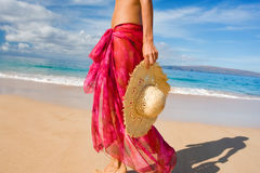 Sarong hat. Woman with beautiful pink sarong on tropical beach Royalty Free Stock Photo