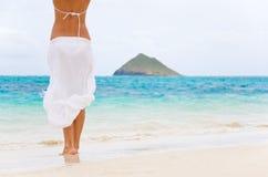 Sarong white beach hawaii. Woman in white sarong blowing in the sea breeze on lanikai beach hawaii Stock Photo