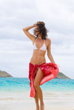 Sarong woman. Woman in red sarong on tropical lanikai beach oahu, hawaii Stock Images