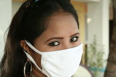 Sars 3. An asian woman wearing a surgical mask to prevent bird flu Stock Photography