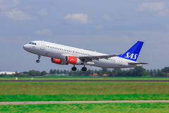 SAS Airbus A320 take-off. SAS (Scandinavian Airlines System) Airbus A320 takes off from runway royalty free stock photo