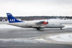 SAS ATR 72-600. SAS Scandinavian Airlines ATR 72-600 taxiing in the snow at Stockholm Arlanda airport in Sweden stock photos