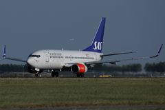 SAS Scandinavian Airlines airplane taxiing in AMS Airport. SAS Scandinavian Airlines airplane doing taxi in Amsterdam Schiphol Airport, Netherlands stock photography
