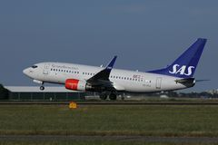SAS Scandinavian Airlines airplane landing in AMS Airport. SAS Scandinavian Airlines airplane lands in Amsterdam Schiphol Airport, Netherands royalty free stock photography