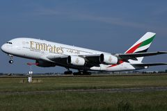 Emirates airplane landing in AMS Airport. Emirates Airbus A380 Airlines airplane lands in Amsterdam Schiphol Airport, Netherands stock photography
