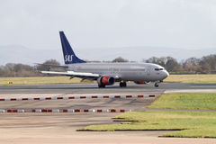SAS Scandinavian Airlines Boeing 737. Manchester, United Kingdom - February 16, 2014: SAS Scandinavian Airlines Boeing 737 taxiing on runway Royalty Free Stock Photos