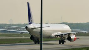 SAS Scandinavian Airlines plane taxiing in Frankfurt Airport, FRA stock footage