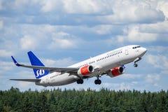 SAS skandinaviska flygbolag, Boeing 737 - 800 tar av fotografering för bildbyråer