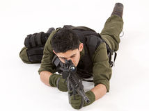 SAS Soldier in Prone pose. Special forces soldier aiming rifle from a prone position royalty free stock image