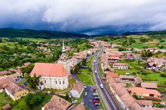 Saschiz saxon village and fortified Church in middle Transylvani. A, Romania, Eastern Europe. Aerial view from a drone Royalty Free Stock Photos