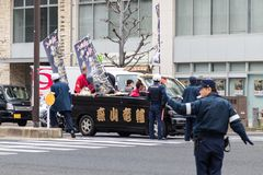 Sasebo, Japan - 07JAN2018: Japanese police directing traffic during coming of age day in Japan. Japanese police directing traffic during the coming of age day Stock Photography
