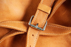 Sash and metal on leather. Sash and metal accessories for leather luggage Royalty Free Stock Photography